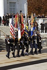 Picture of the US & military flags being carried by military honor guard members