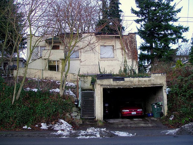 Picture of a poorly maintained home and garage