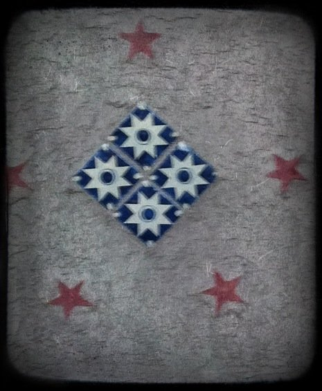 Picture of a tile square embedded in the wall at Crystal Park Cantina in Manitou Springs