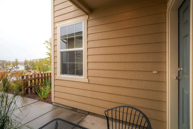Picture of front porch area looking into street of 1831 Portland Gold Dr Colorado Springs CO 80905