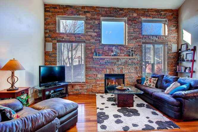 Picture of window wall with fireplace and stone wall inside 1445 Gumwood Colorado Springs CO