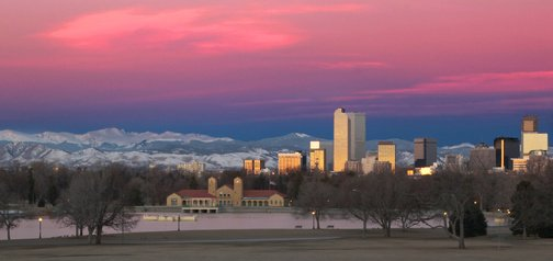 Picture of the Denver skyline in winter with the rocky mountains in the background