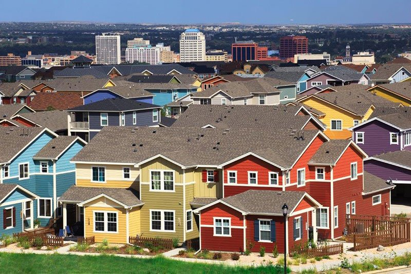 Aerial view of Gold Hill Mesa homes with downtown Colorado Springs in the background