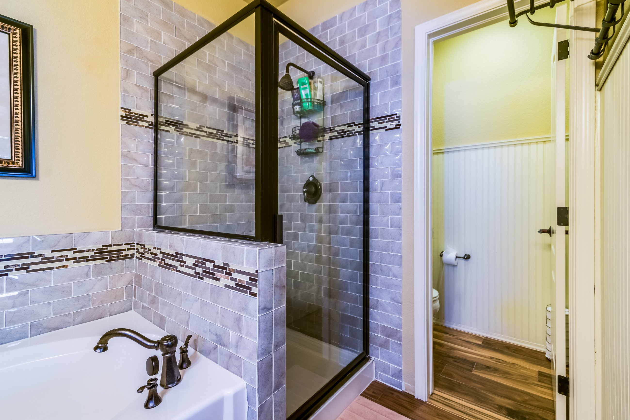 Gold Hill Mesa Master bathroom, separate shower and tub with stunning tile accents