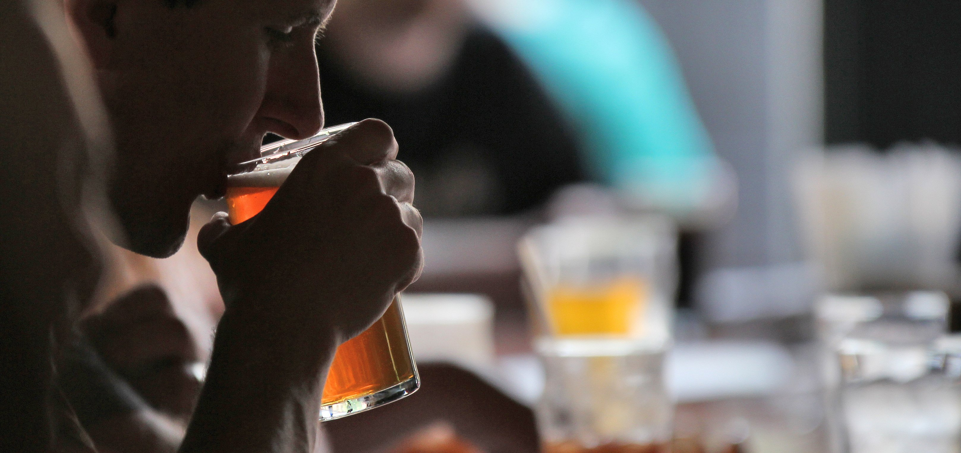 Man drinking a glass of beer in Colorado Springs