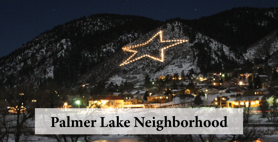 Palmer Lake neighboorhood with star lit up on mountain