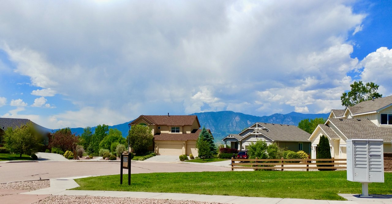 Pictures of homes in a cul de sac in southeast Colorado Springs with Cheyenne Mountain in the background