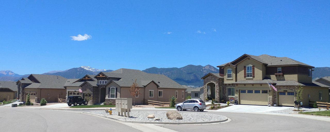 a view of homes with Pikes Peak in the background from north Colorado Springs