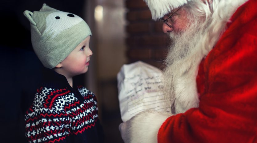 Young boy meeting with Santa