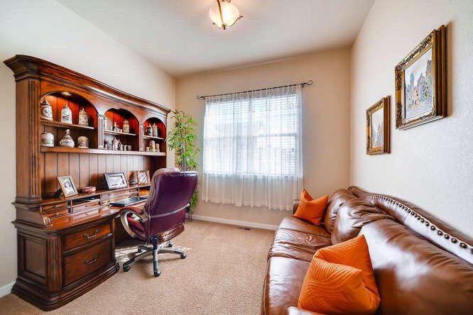 The office at 1290 Gold Hill Mesa Drive with a leather couch on one wall