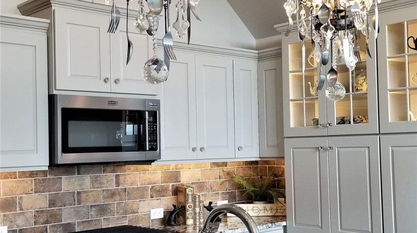 Creative kitchen chandeliers made with knives and spoons