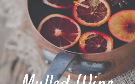 Mulled wine in simmering pot with caption