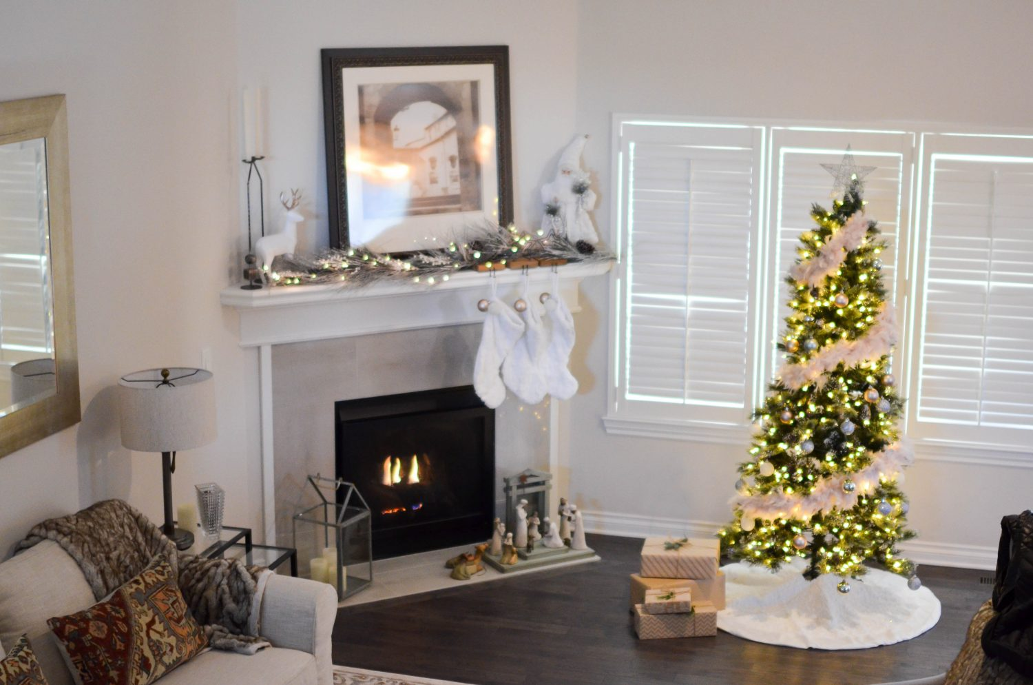 Living room and fireplace decorated for Christmas