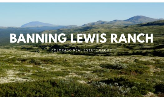 Banning Lewis Ranch text overlaid on picture of field with mountains