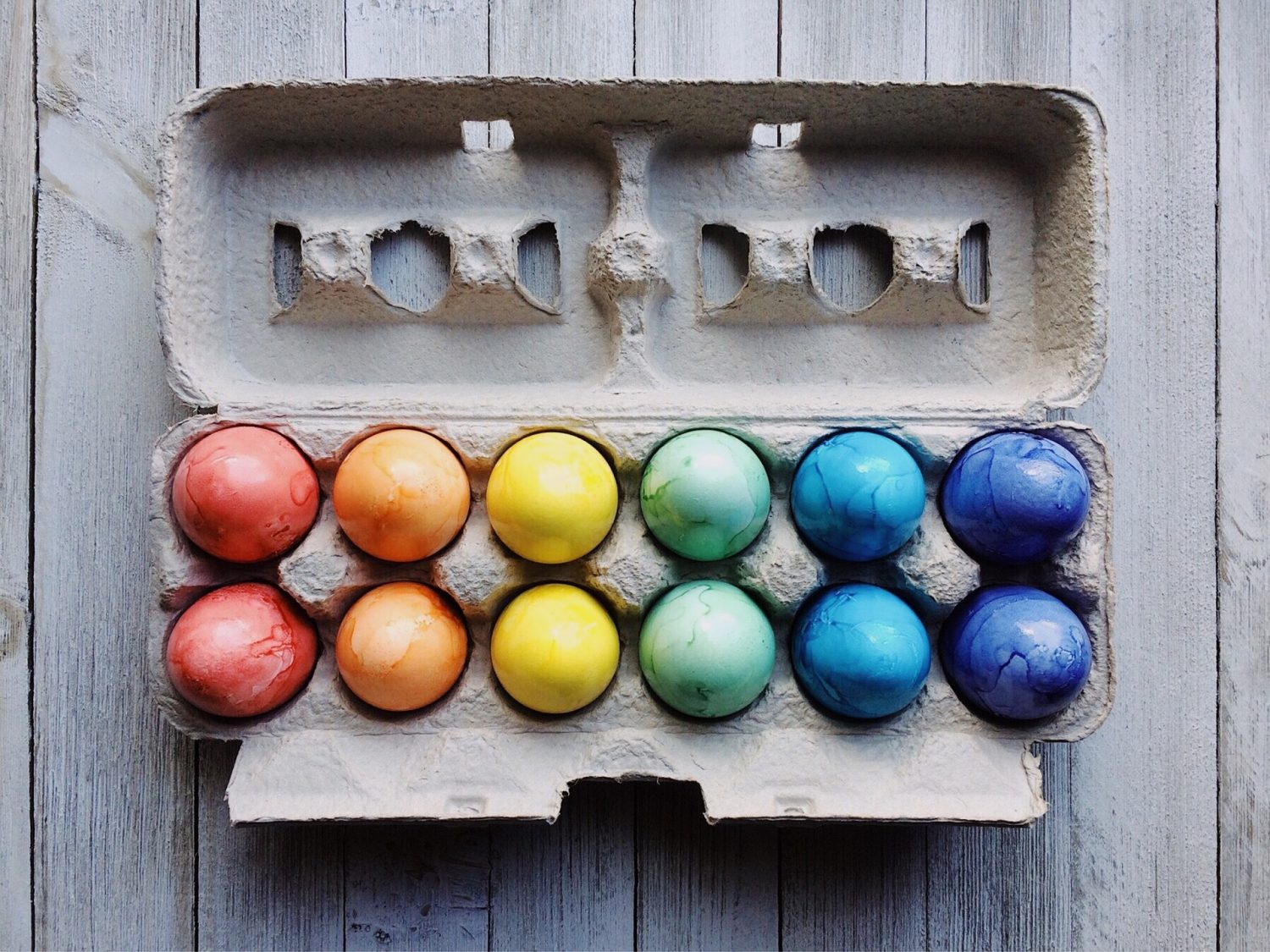 Picture of a dozen eggs dyed for Easter