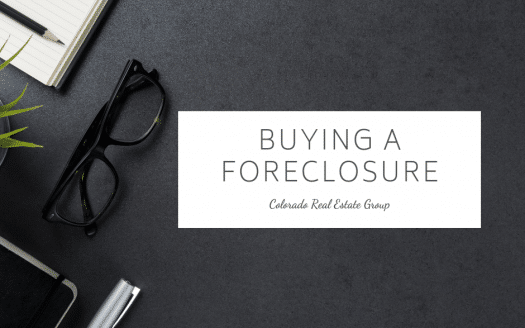 "Picture of notebook, glasses, pen and plant with ""Buying a Foreclosure"" text"