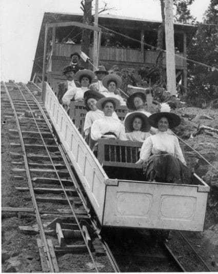 black and white image of people on Cog Railway in Manitou Springs, CO