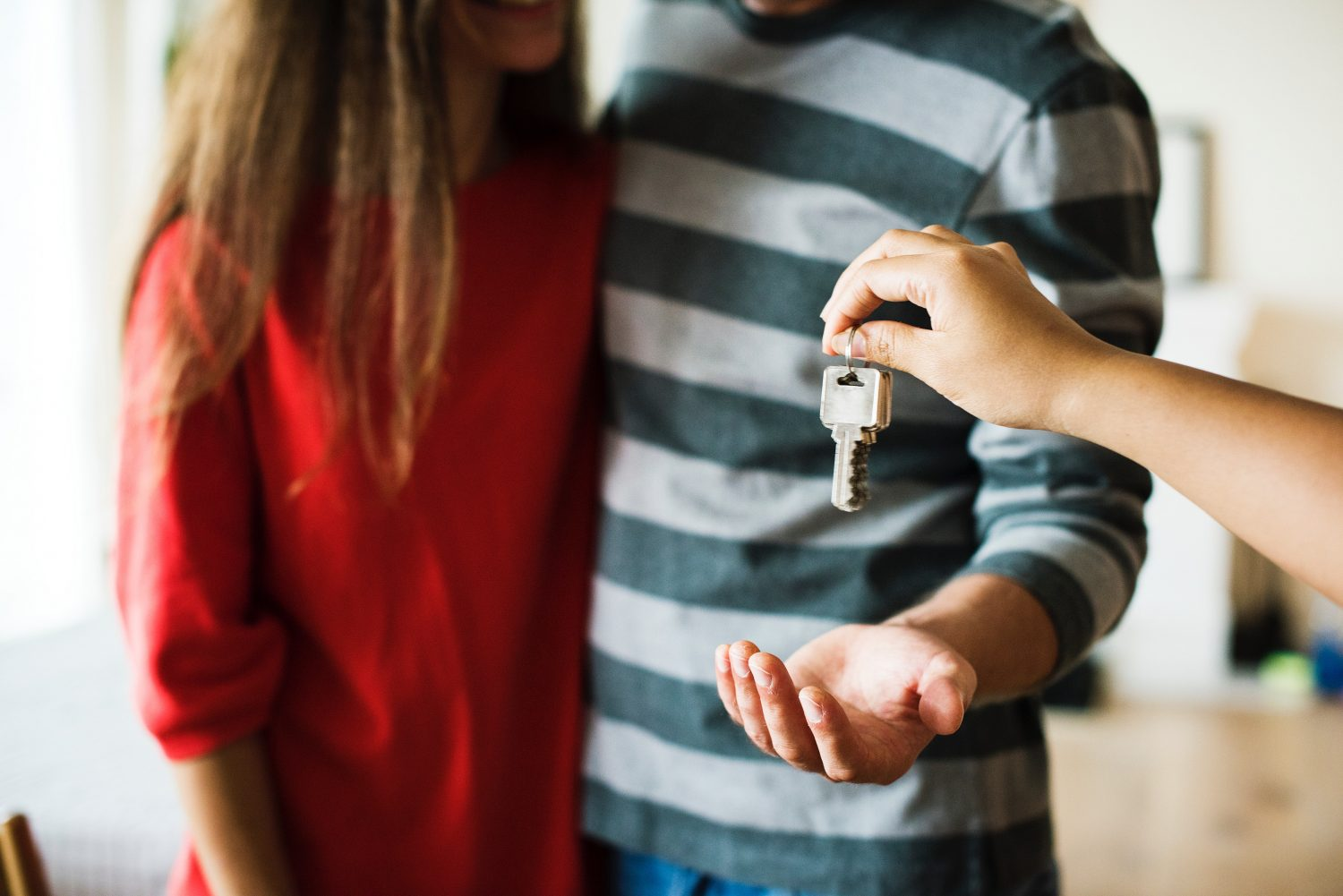picture of two people receiving key