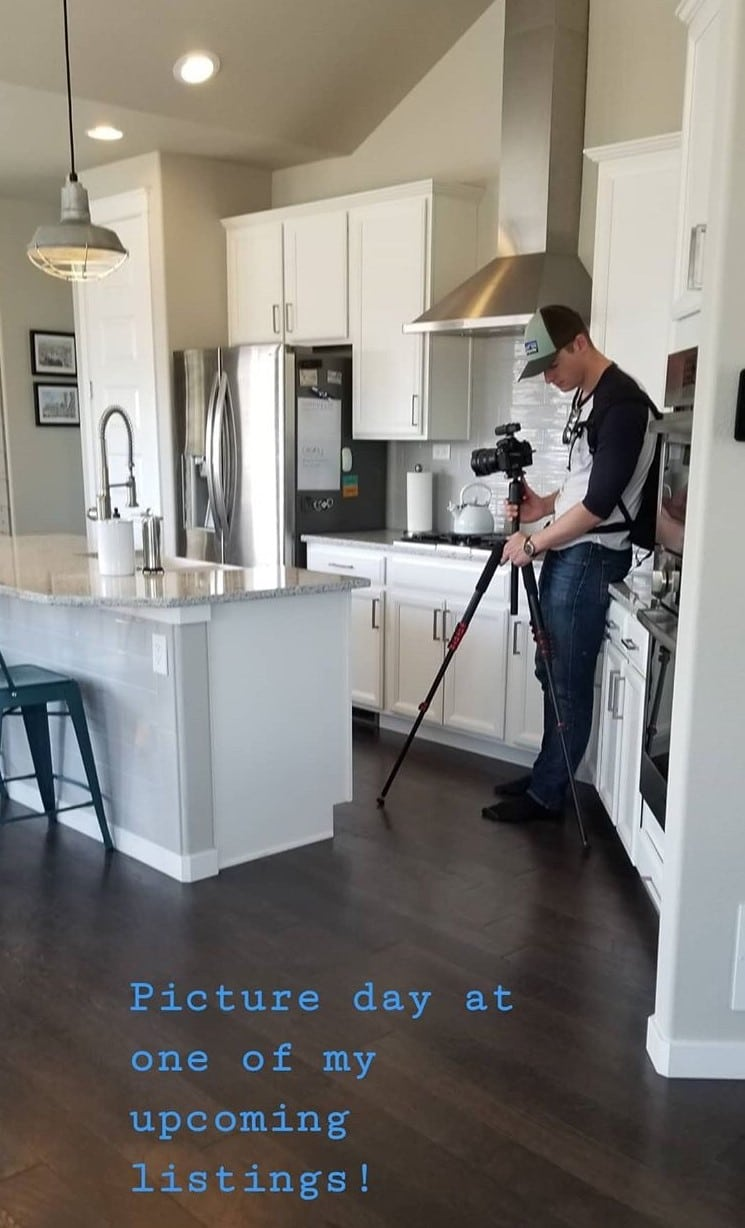image of photographer taking pictures inside home