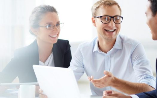 Three people smiling captioned with Schedule the Closing