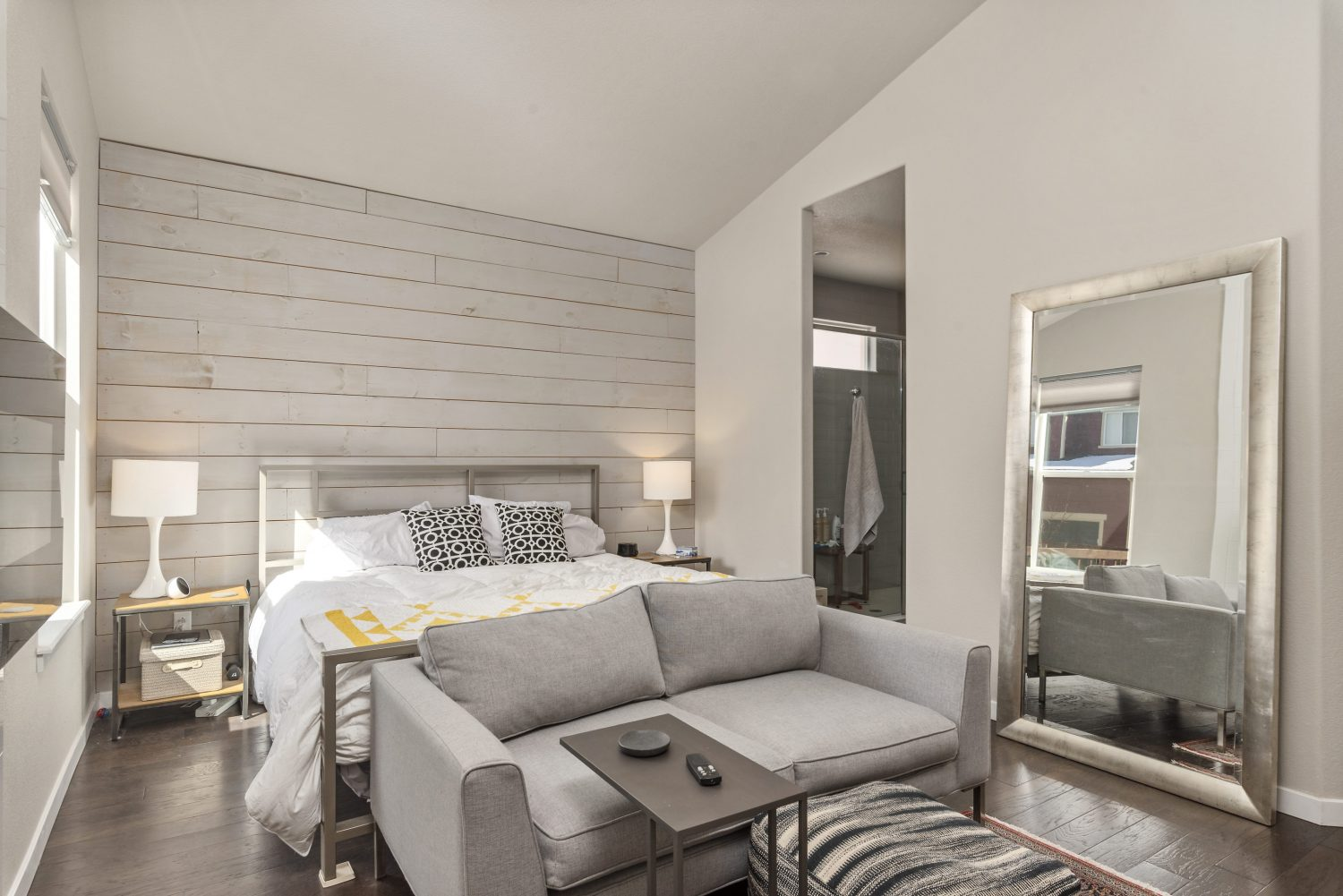 picture of master bedroom with grey accents.