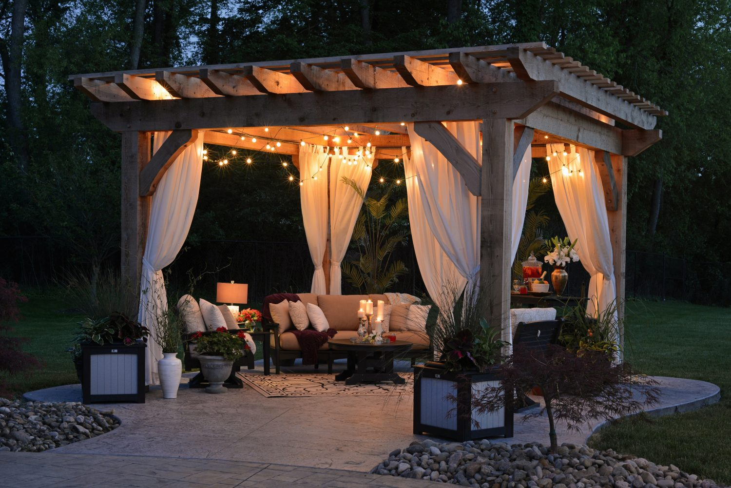 picture of backyard gazebo with lights and candles