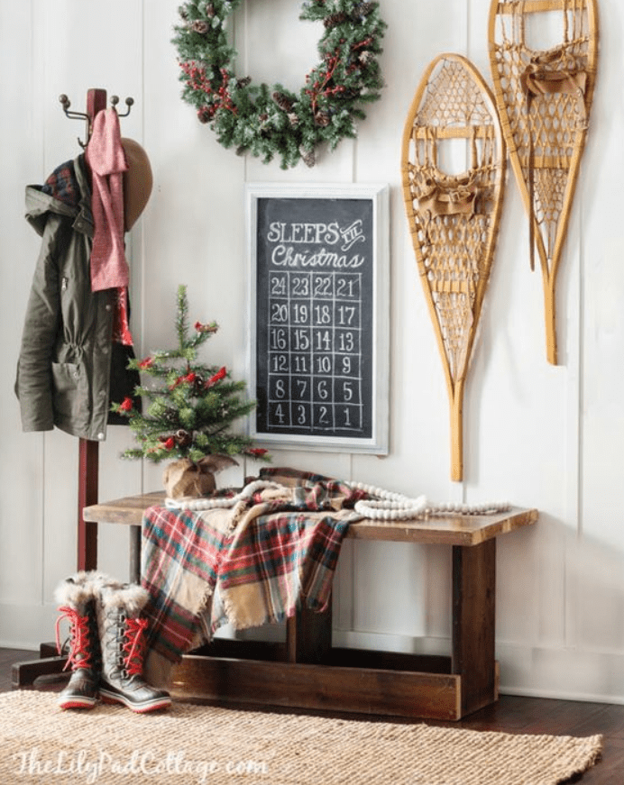 picture of entryway with bench, Christmas decorations and antique snowshoes