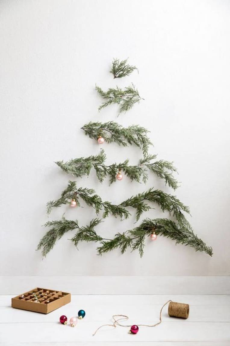 picture of minimalist Christmas tree created by arranging branches on a wall