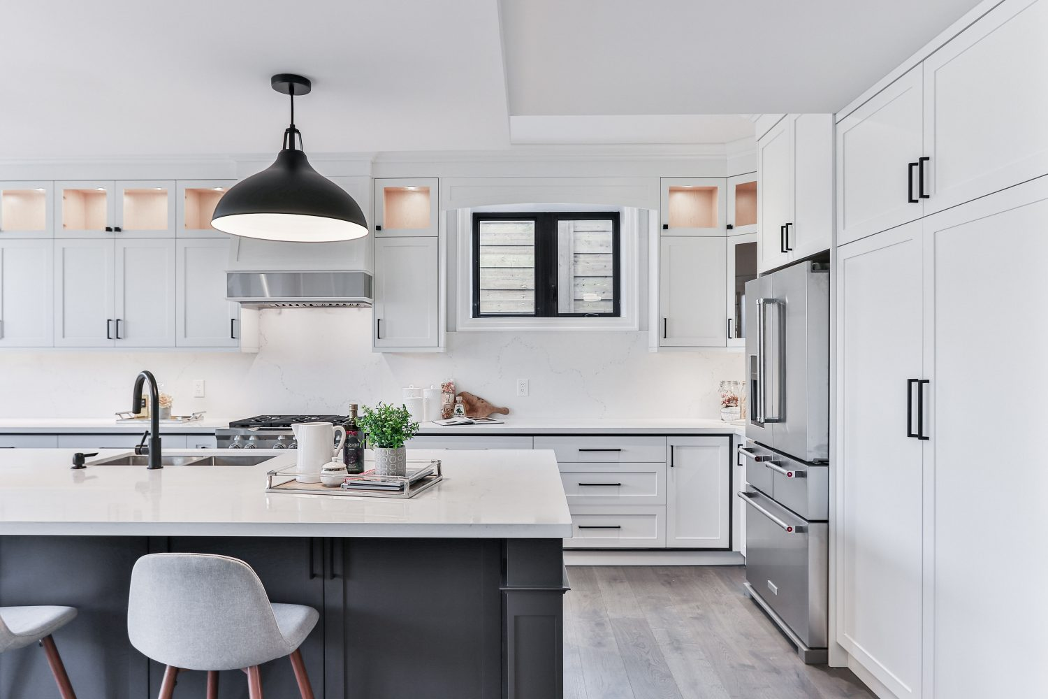 photo of white kitchen with black accents